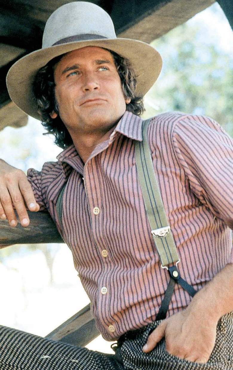 little house on the prairie cast charles posing in a barn