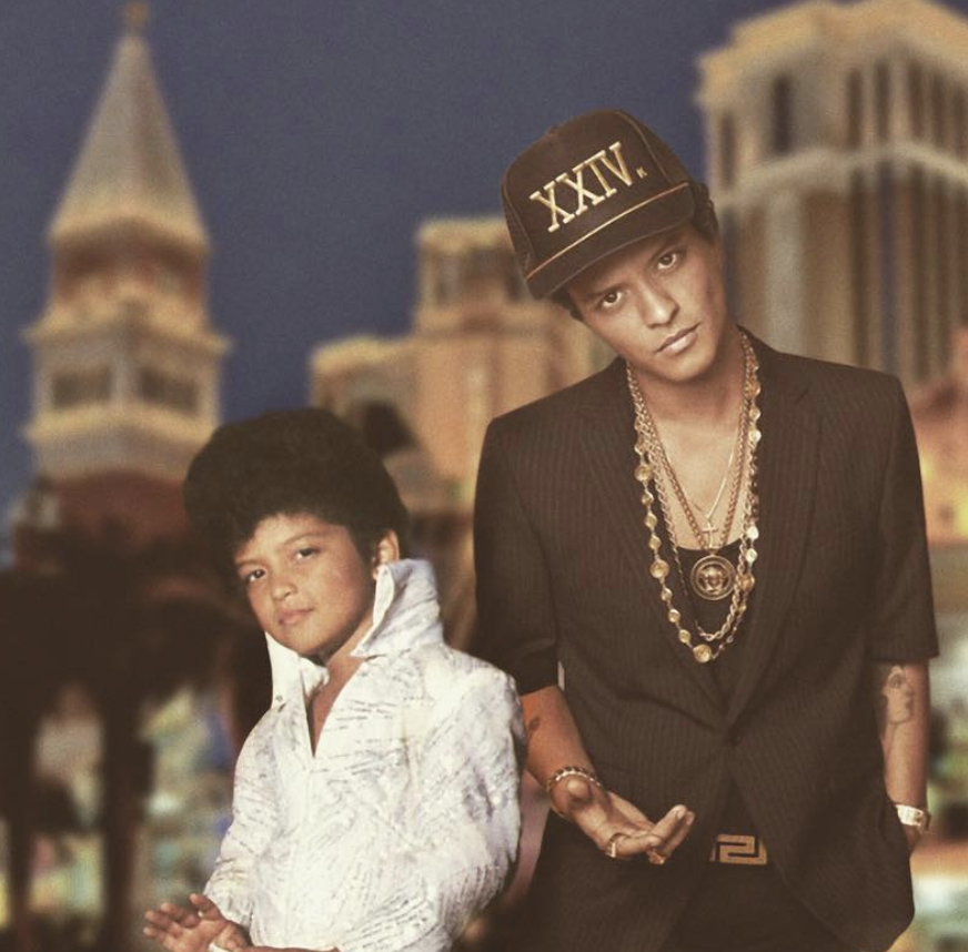 bruno mars posing next to a picture of himself