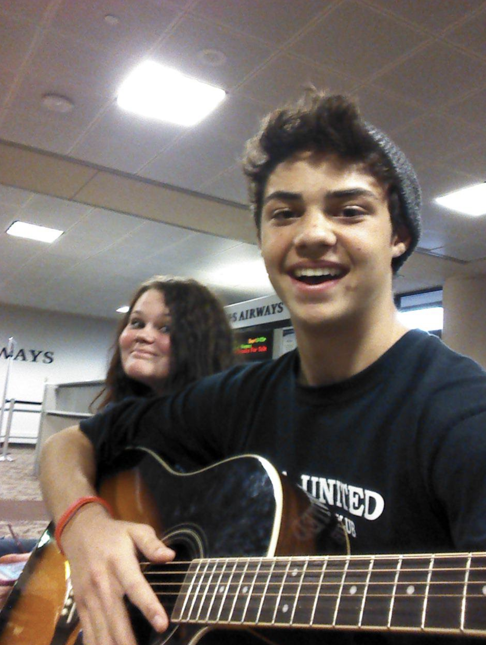noah centineo playing guitar